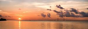 A Peaceful Sunrise Scene of the Tampa Bay and Skyway Bridge in Florida by Sheila Haddad