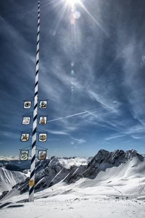 Bavarian Alps, Zugspitze, Germany and Maypole in Winter Vertical by Sheila Haddad