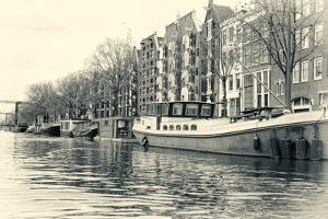 Historic Houses and Boats Along a Canal, Netherlands by Sheila Haddad