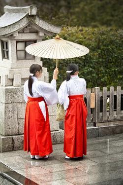 Japanese Girls in Red Hakama with Umbrella in Rain Kamakura Japan by Sheila Haddad