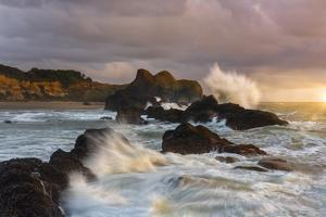 Large waves crashing against the sea stacks along the beach of Seal Rock. by Sheila Haddad