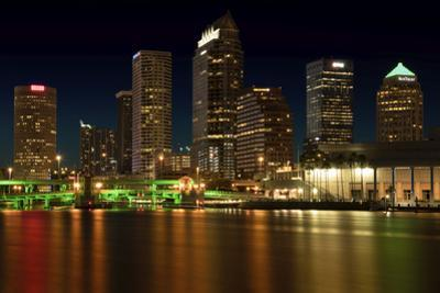 Long exposure of the skyline of Tampa at night along the Hillsborough River by Sheila Haddad