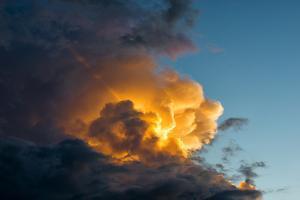 Orange Streak of Light Pierces Dramatic Cloud Formation by Sheila Haddad
