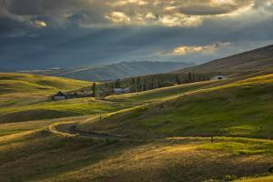 Ranch nestled in the rolling hills near Painted Hills, Oregon at sunset by Sheila Haddad