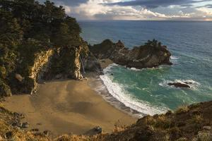 Soft golden light of sunset shining on the cover of McWay Falls, Julia Pfeiffer Park, Big Sur by Sheila Haddad