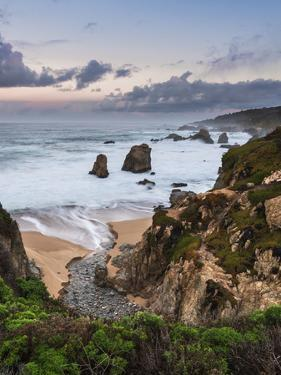 Stream flowing into the Pacific Ocean at Soberanes Point with the coastline in view by Sheila Haddad