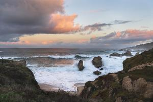 Sunrise in the clouds alone the coast of Soberanes Point in Big Sur, California. by Sheila Haddad