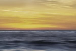 Sunset colors in the sky over the smooth ripples of the ocean by Sheila Haddad
