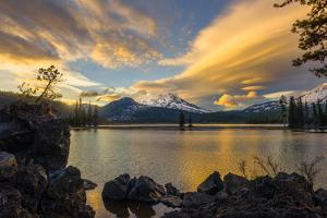 Sunset colors reflect off Diamond Lake from the lenticular clouds by Sheila Haddad