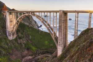 The backside view of Bixby Bridge against the Pacific Ocean by Sheila Haddad