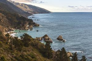 View south of Big Sur coastline with little arch rock in Ocean waters by Sheila Haddad