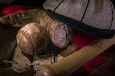 Vintage baseball paraphernalia laid out carefully painted with light by Sheila Haddad