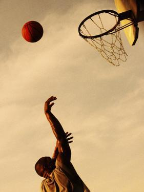 Side Profile of a Mid Adult Man Playing Basketball