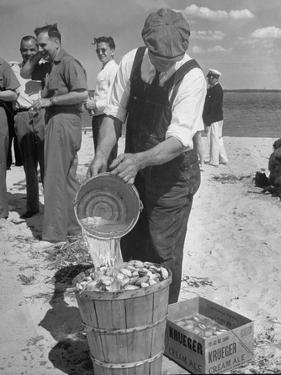 Sights of a Typical Summer at Cape Cod: Watering Clams to Aid the Steaming for Clambake