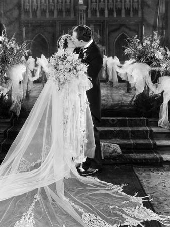 https://imgc.allpostersimages.com/img/posters/silent-film-still-wedding_u-L-Q10V78H0.jpg?artPerspective=n