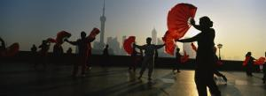 Silhouette of a Group of People Dancing in Front of Pudong, the Bund, Shanghai, China