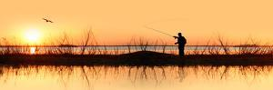 Silhouette of a Man Fishing