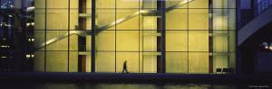 Silhouette of a Person Walking in Front of a Building, Paul Lobe Haus, Berlin, Germany