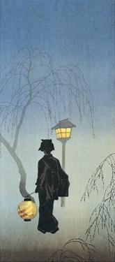 Silhouette of a Woman Holding a Japanese Lantern and Walking