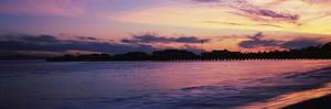 Silhouette of pier in pacific ocean, Santa Barbara, California, USA