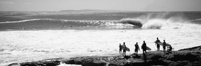 Silhouette of Surfers Standing on the Beach, Australia