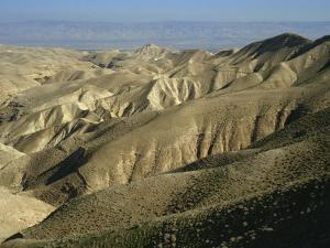 Arid Hills at Wadi Qelt and the Valley of the River Jordan in Judean Desert, Israel, Middle East by Simanor Eitan