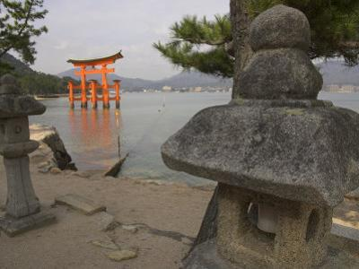 Traditional Stone Candle Stands with Floating Torii Beyond, Itsuku Shima Jinja, Honshu, Japan