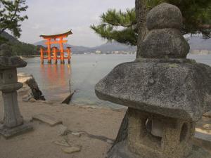 Traditional Stone Candle Stands with Floating Torii Beyond, Itsuku Shima Jinja, Honshu, Japan by Simanor Eitan