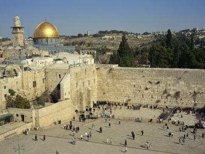 Western or Wailing Wall, with the Gold Dome of the Rock, Jerusalem, Israel