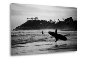 Female Surfer Heading Out by Simeon Rodgers