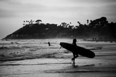 Female Surfer Heading Out