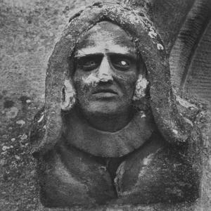 Stone Carving of a Man's Head, Toddington Manor, Gloucestershire by Simon Marsden