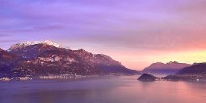 Bellagio and Varenna viewed from Menaggio on the western shore of Lake Como at sunset, Italy by Simon Montgomery