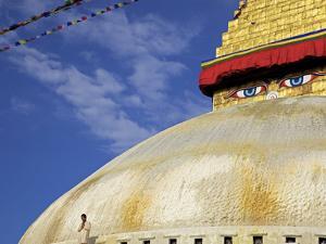 Man Praying in Front of the Dome of Boudha (Bodhnath) (Boudhanath) Stupa, Kathmandu, UNESCO World H by Simon Montgomery