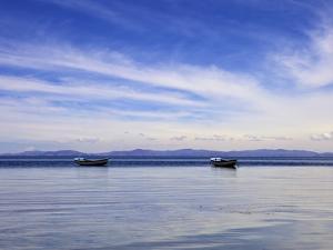 Two Boats on the Lake, Kollabaya, Challapampa, Isla del Sol, Lake Titicaca, Bolivia, South America by Simon Montgomery
