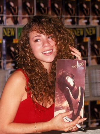 Singer Mariah Carey Signing Autographs During Personal Appearance