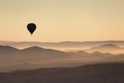 https://imgc.allpostersimages.com/img/posters/single-hot-air-balloon-over-a-misty-dawn-sky-cappadocia-anatolia-turkey-asia-minor-eurasia_u-L-PWFHRN0.jpg?p=0