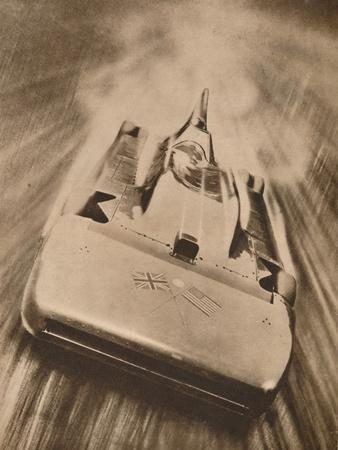 https://imgc.allpostersimages.com/img/posters/sir-malcolm-campbell-at-high-speed-in-blue-bird-1935_u-L-Q1EF9X30.jpg?artPerspective=n