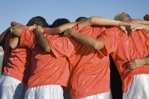 Rear View of Young Soccer Players Discussing Strategy by sirtravelalot