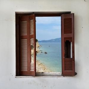 Beach Landscape Through Broken Window by sirylok