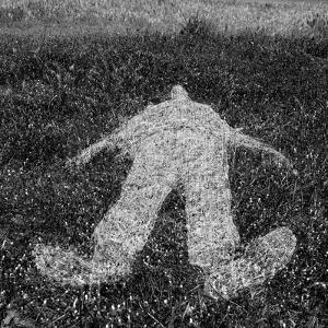 Human Figure Outline Imprinted On Grass by sirylok