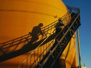 A Workman Climbs a Stairway on a Petroleum Storage Tank by Sisse Brimberg