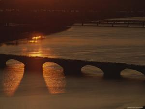 Sunlight Reflects off the Potomac, Silhouetting Memorial Bridge by Sisse Brimberg