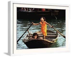 Sisters Who Live with Their Family on Halong Bay, Vietnam, Row Their Boat out to Greet Tourists