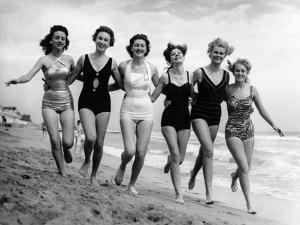 Six Women, in Swimsuits, Run in a Row Along a Beach, 1942