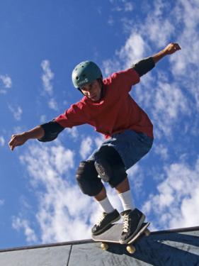Skateboarder in Action on the Vert