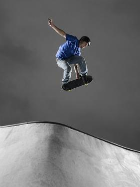 Skateboarder Performing Tricks