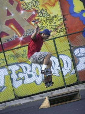 Skateboarder with Graffiti Background