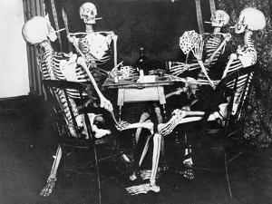 Skeletons Smoking While Playing Bridge