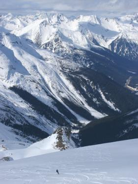 A Back-Country Snowboarder Descends a Snowfield Near Rogers Pass by Skip Brown